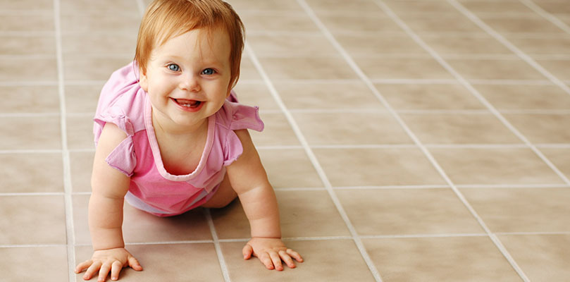 Baby on tile floor